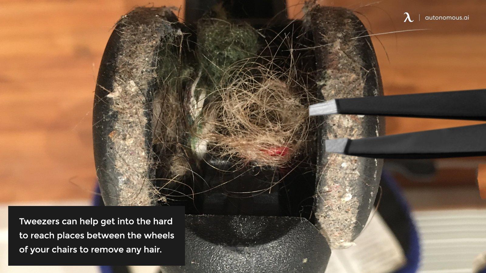 Using tweezers to remove hair
