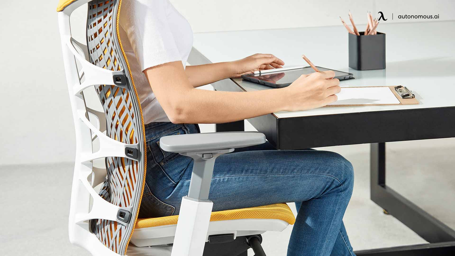 Sit as close to the desk as you comfortably can