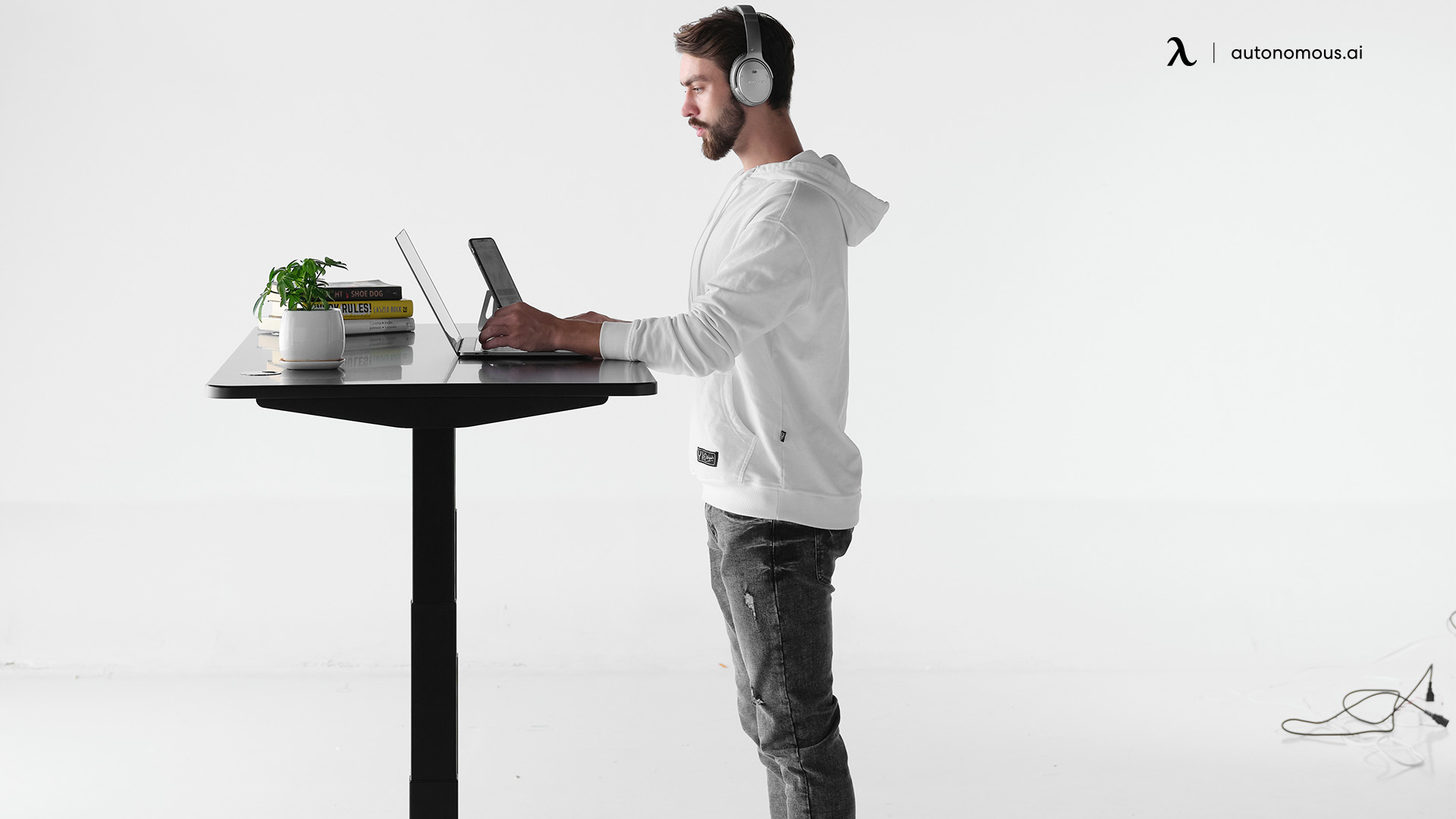 What is an adjustable intelligent standing electric desk?